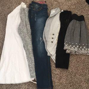 Bundle of women's size medium clothes.